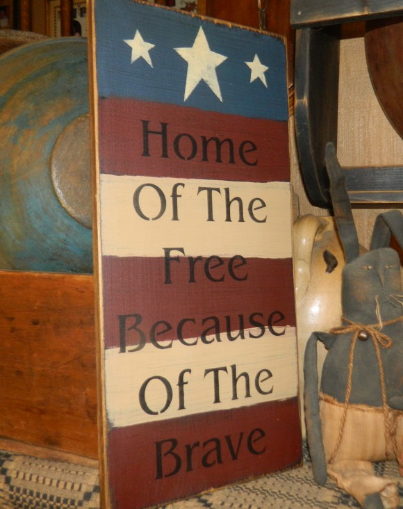 HOME OF THE FREE PRIMITIVE SIGN SIGNS